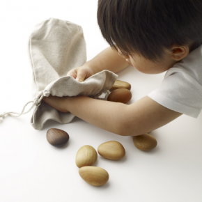 Play With Sleek and Simple Wooden River Pebbles