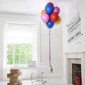 Permanent Helium Balloons & Jenga Blocks Holding Up Your Office Desk