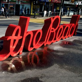To the Beach: A Bright Red, Ten-Layered Typographic Bench