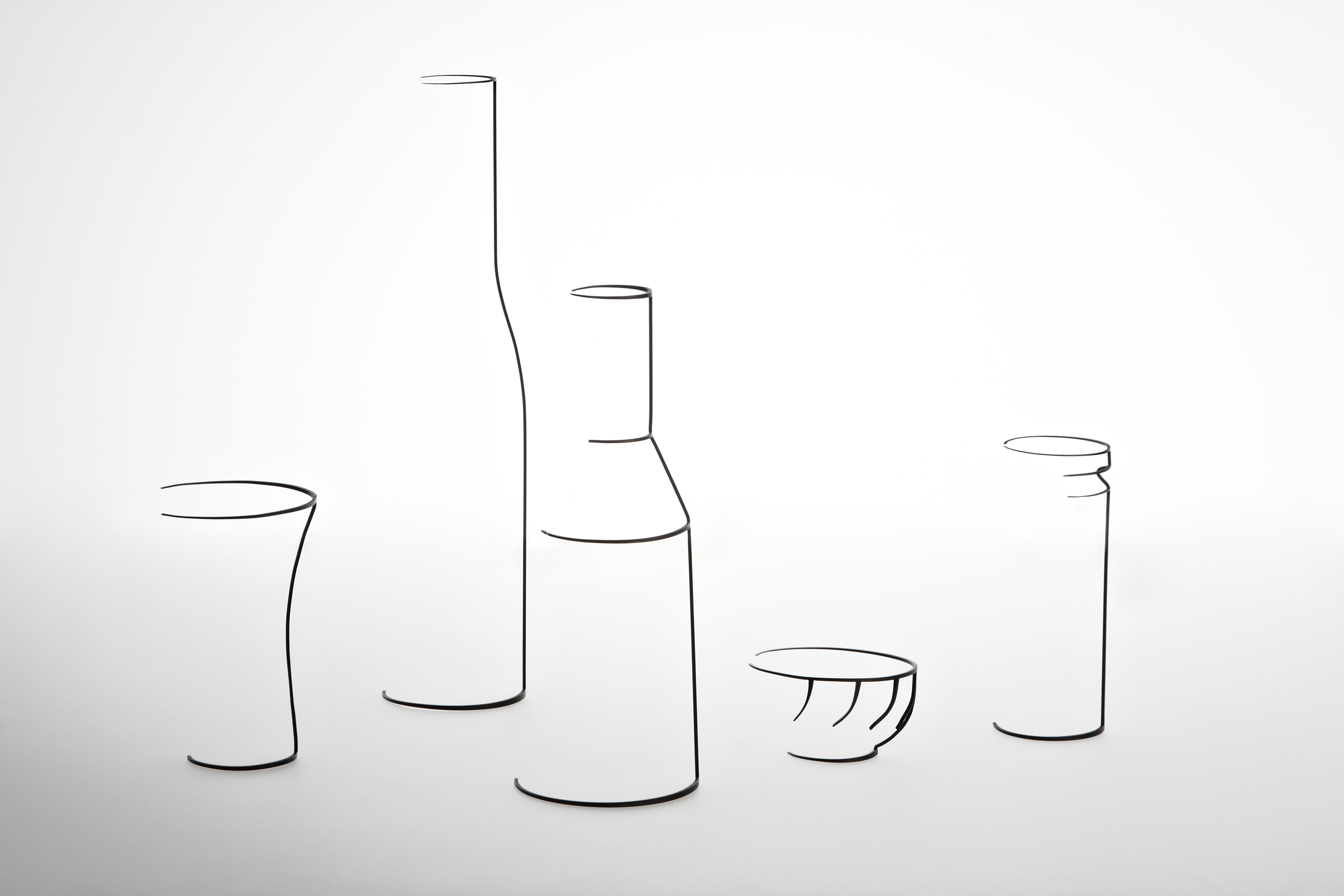 subtle line sculptures tracing the outlines of familiar objects
