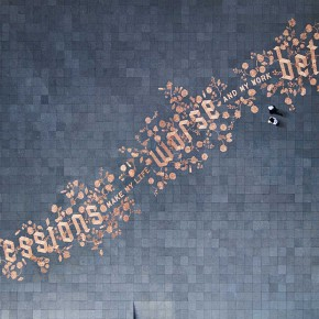 250,000 Shiny Eurocents Lined Up in Precise Public Art Calligraphy